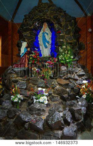 PASTO, COLOMBIA - JULY 3, 2016: sanctuary of the lourdes virgin located in la cocha lake.