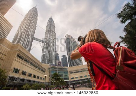 KUALA LUMPUR, MALAYSIA - AUGUST 20, 2016 : The Petronas Twin Towers in Kuala Lumpur, Malaysia are the world's tallest twin tower. The skyscraper height is 451.9m