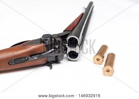 Shotgun with two bullets on white background