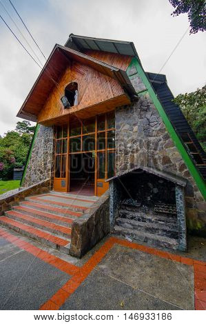 PASTO, COLOMBIA - JULY 3, 2016: side view of the sanctuary of the lourdes virgin located in la cocha lake.