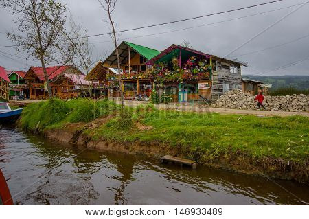 PASTO, COLOMBIA - JULY 3, 2016: some houses located next to the shore in la cocha lake close to the city of pasto.