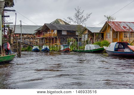 PASTO, COLOMBIA - JULY 3, 2016: some boats parked on the side of the small river close to la cocha lake.