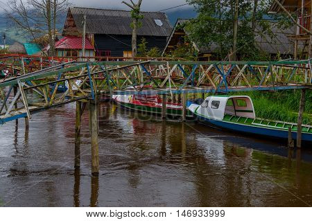 PASTO, COLOMBIA - JULY 3, 2016: some colorfull boats parked under two small bridges.