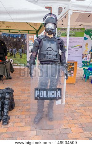 PASTO, COLOMBIA - JULY 3, 2016: manikin dessed with police equipment standing in front of a police stand.