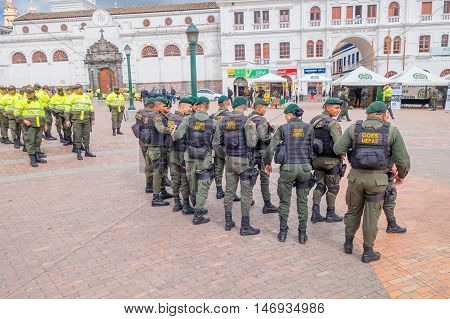 PASTO, COLOMBIA - JULY 3, 2016: police squad wearing lifejackets standing on the central square of the city.