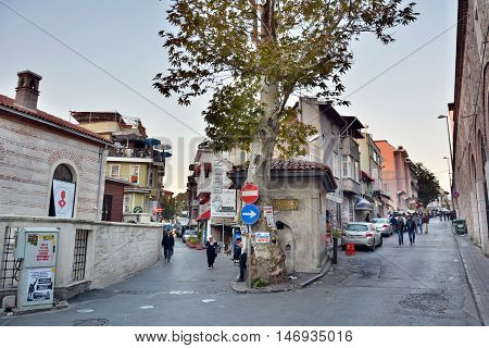 Istanbul, Turkey - November 4, 2015. Street view in Beyazit neighborhood of Istanbul, with buildings, cars, traffic signs and people.