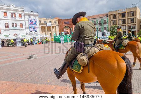 PASTO, COLOMBIA - JULY 3, 2016: police officers riding horses on the central square of the city.