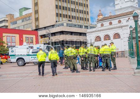 PASTO, COLOMBIA - JULY 3, 2016: police squad wearing uniform standing on the central square of the city.