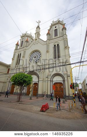 PASTO, COLOMBIA - JULY 3, 2016: unidentified people walking on the street close to a church.