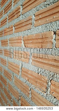 close up brick wall at construction site prepared for plastering and painting