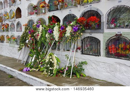 TULCAN, ECUADOR - JULY 3, 2016: some floral decorations outside of the vertical graves.