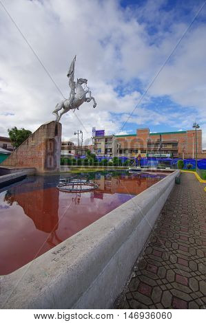 TULCAN, ECUADOR - JULY 3, 2016: the statue of simon bolivar riding a horse is located in an important park of the city.