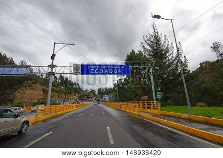 TULCAN, ECUADOR - JULY 3, 2016: boarder road between colombia and ecuador, thank you for visiting ecuador sign.