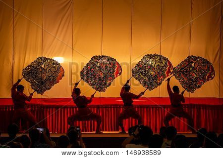 RATCHABURI THAILAND - MARCH 20: Large Shadow Play is performed at Wat Khanon on March 20 2016. The ancient performing art involves manipulating puppets of cowhide in front of a backlit white