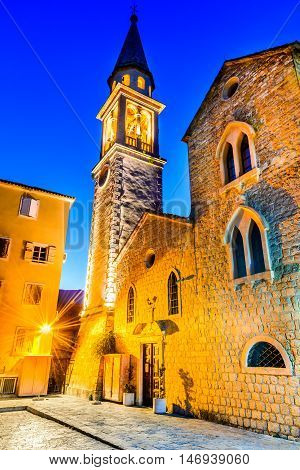 Budva Montenegro. Sveti Ivan (St. John) Catholic Church Cathedral rises over the old town and harbor.