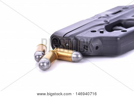 Bullets with the gun on white background.