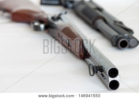 Hunting rifles - modern rifles and modern shotgun isolated on white background