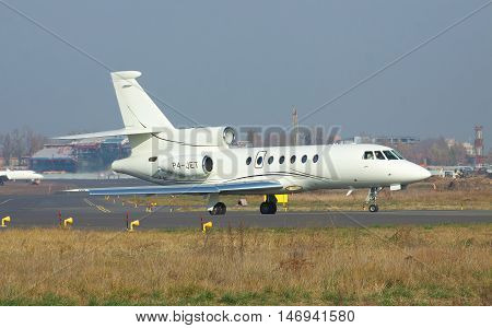 Kiev Ukraine - November 5 2011: Dassault Falcon 50EX business jet is on the runway in the airport before takeoff