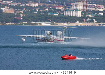 Gelendzhik Russia - September 8 2010: Beriev Be-200 amphibian plane is preparing for a takeoff from water surface