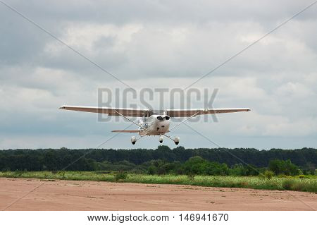 Zhitomir Ukraine - July 31 2011: Cessna 172S Skyhawk XP is taking off from runway into cloudy sky for a leisure flight