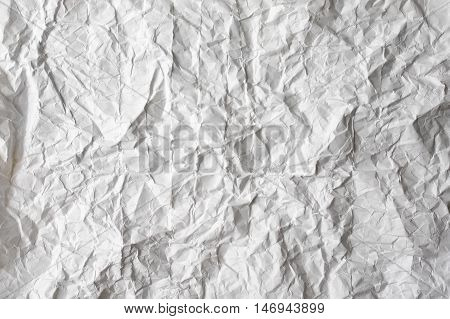 Empty light gray and white natural clean paper texture jammed and crumpled with folds and wrinkles