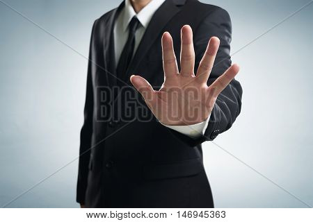 Hand stop shown by business men .