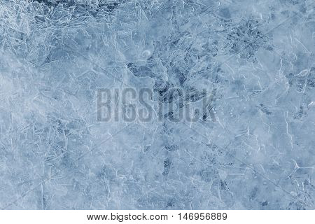 Texture ice surface of a mountain river close up abstract winter background
