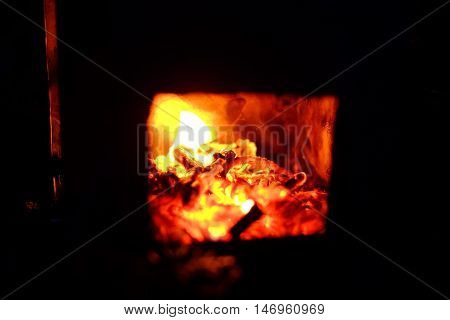 Burning Wood In The Furnace