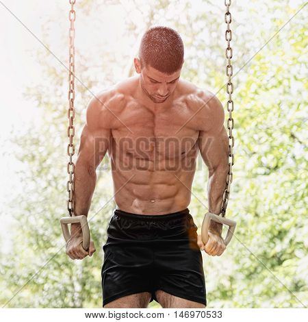 Muscular Man On Gymnastic Rings