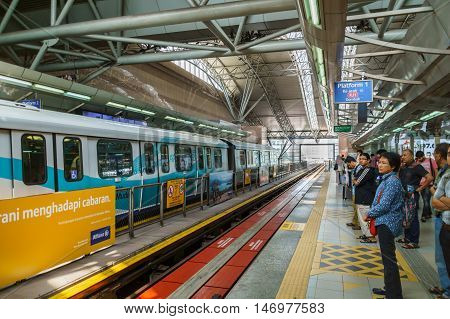 Kuala Lumpur Malaysia - circa August 2016: Rapid KL LRT train platform with people waiting. Rapid KL is a new public transportation network in Kuala Lumpur and  provides transportation service with 60 stations in Kuala Lumpur Malaysia.