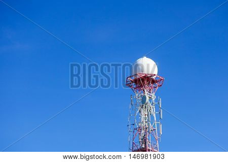 Radar dome in the sea with blue sky and clouds background.