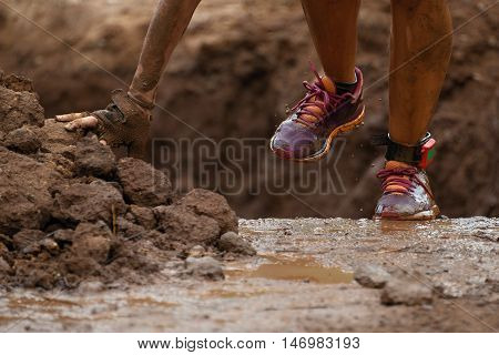 Mud race runners detail sports shoes.Extreme sport