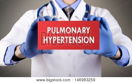 Doctor's hands in blue gloves shows the word pulmonary hypertension. Medical concept.