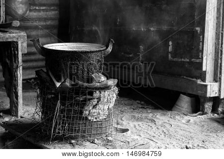 Cook with charcoal. Kitchen Thai traditional charcoal burning clay stove. Black and white color low key.