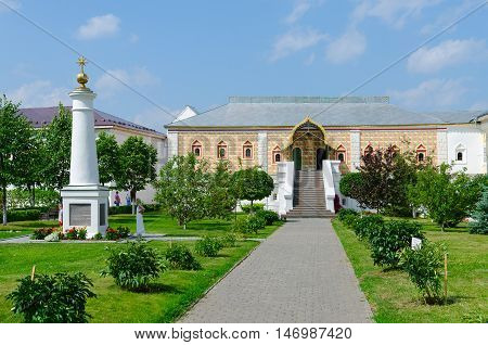 KOSTROMA RUSSIA - JULY 20 2016: Unidentified people are on territory of Holy Trinity Ipatyevsky male monastery near House of Romanov boyars and memorial column Kostroma Russia