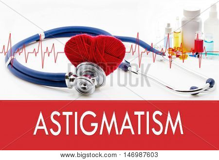 Medical concept astigmatism. Stethoscope and red heart on a white background