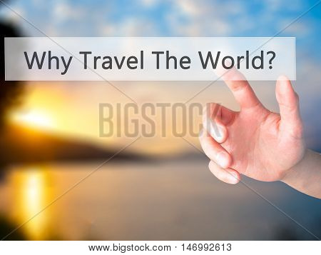 Why Travel The World ? - Hand Pressing A Button On Blurred Background Concept On Visual Screen.