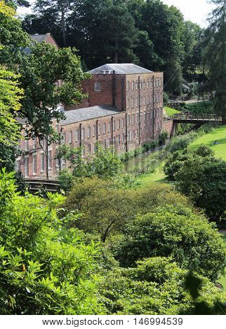 MANCHESTER, ENGLAND, AUGUST 25 2016: The 18th century Quarry Bank Mill at Styal near Manchester. Owned by the National Trust, it was the setting for the TV series 'The Mill'.