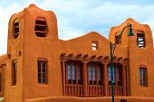Historic adobe style building with observation towers taken in Santa Fe, NM poster