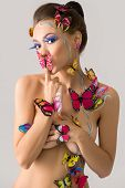 Bodyart. Beautiful nude girl posing with butterflies poster
