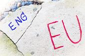 Brexit UK EU referendum concept with word UN and Eng on stone wall poster