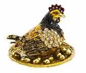 A souvenir hen decorated with strasses and many golden eggs poster
