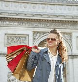 Stylish autumn in Paris. happy young fashion-monger with shopping bags in Paris France looking into the distance poster
