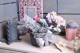 Interior decorations for the winter holydays in grey and pink colors