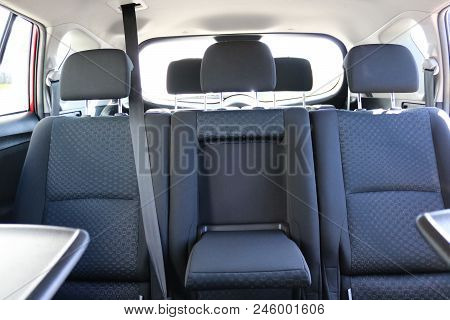 Car Interior. Rear Seats Of A Car Interior. Car Interior With Back Seats, Sunlight Flaring Through.