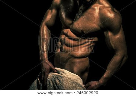 Live Statue Of An Athlete. Sport And Workout. Athletic Bodybuilder Man On Black Background. Man With