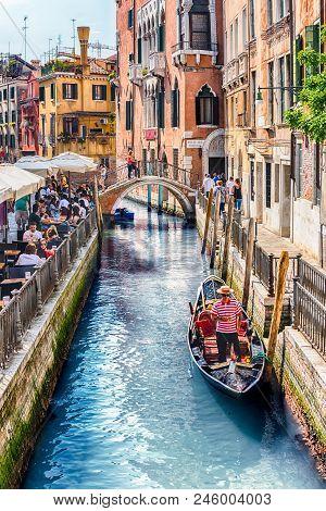 Venice, Italy - April 29: Traditional Gondolas With Scenic Architecture Along The Canal Rio Di S. Pr