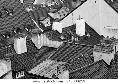 Cityscape. Terracotta Tiled Roofs With Chimneys And Dormer Windows Of City Or Town Houses Buildings