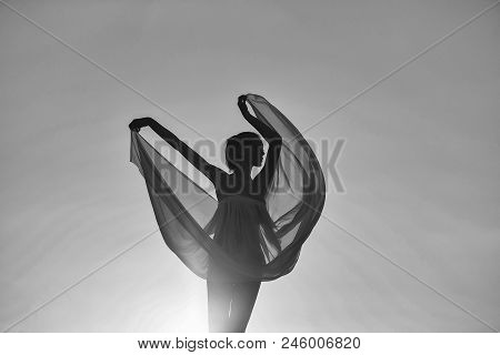 Female Silhouette. Silhouette Of Slim Girl Young Woman Female Model Dances In Transparent Windy Dres