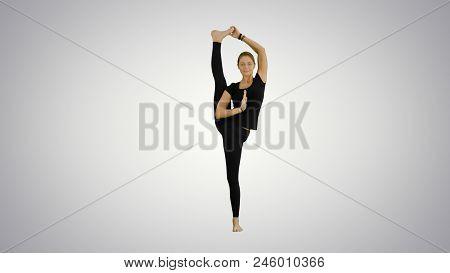 Athletic Girl Standing In Yoga Asana Utthita Hasta Padangustasana, Extended